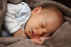 Osteopathy treatment constipation baby sleeping