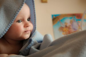 Paediatric orthopaedic check up baby under a blanket