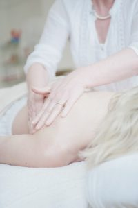 Osteopathy treatment patient with back pain and osteopath