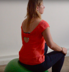 How to exercise during pregnancy: pelvis mobility exercise, pelvis tilt on swiss ball right tilting