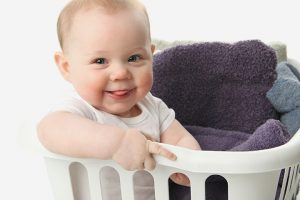 Baby & Child motor development from 15 months old to 4 years infant in a laundry basket