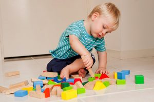Baby & Child motor development from 15 months old to 4 years, infant playing with cube